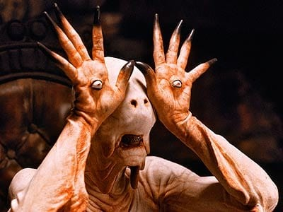 pale man pan's labyrinth monster hand eyes