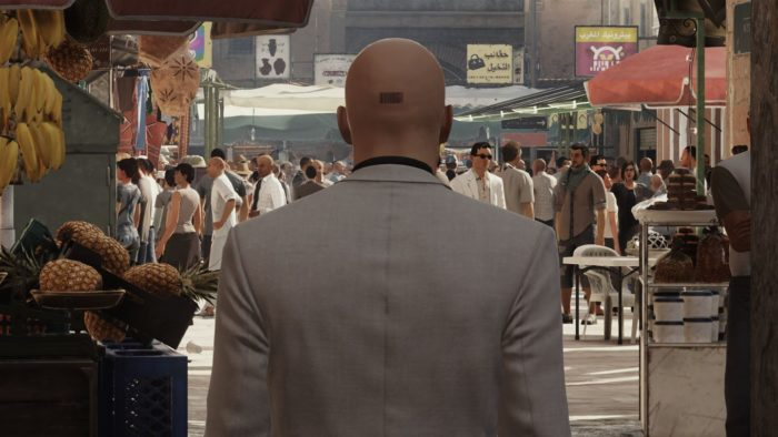 Hitman Agent 47 in crowded market